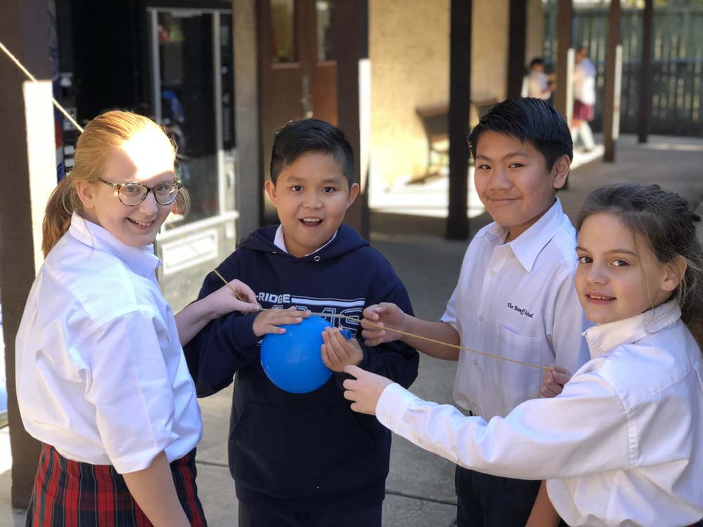 students_doing_stem_experiment